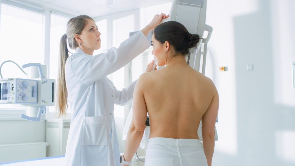 Woman receiving mammogram at the doctor's office.